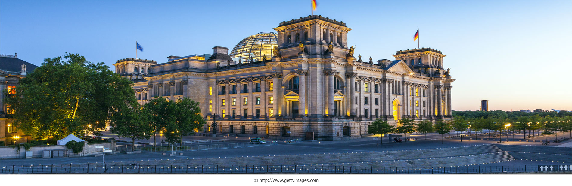Berlin government district with Reichstag and ship on Spree rive